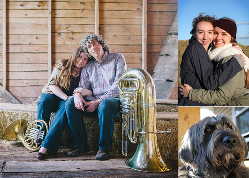 Photo collage containing 3 images. The first is a image of Tracy McLennon embracing a man with curly hair and glasses as she leans against him. They are sitting in an old barn near some bails of hay. Next to them on the ground is a french horn and a tuba. The 2nd image is of her and another woman hugging outside wearing winter jackets. The last photo is f a cute dog with long black hair.