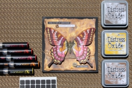 @csmscrapbooker Handmade butterfly card stamped with a Stampin Up butterfly stamp and colored with Chameleon pens. Background of card created with Ranger Oxide inks.
