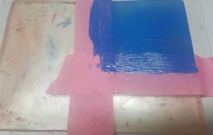 Gel Press monoprinting the American flag using ArtFoamies. Mask off the corner of the gel plate