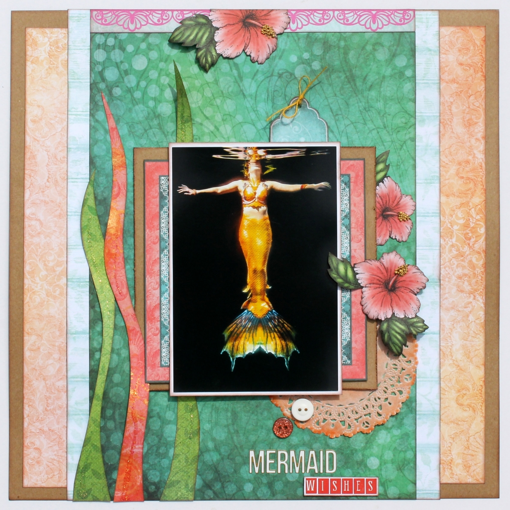 @csmscrapbooker @heartfeltcreations @hcemnalou @sbadhesives3l @scrappychick101 #creativescrapbookermagazine #csmscrapbooker #heartfeltcreations #scrapbookadhesivesby3l #tracymclennon #undertheseacollection #2wayglue #mermaidthemedlayout #mermaidphotos #prills #doilies #designingwithdoilies #fussycutting #simplelayers #scrapbooking #scrapbookinglayout #12X12layout