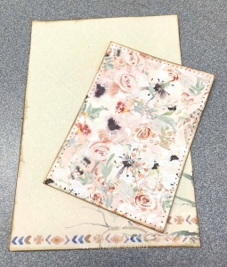 Two sheets of BoBunny patterned paper from the Serendipity collection used to create a card