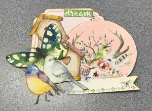 Variety of die cut shapes from the BoBunny Serendipity collection used to create a card