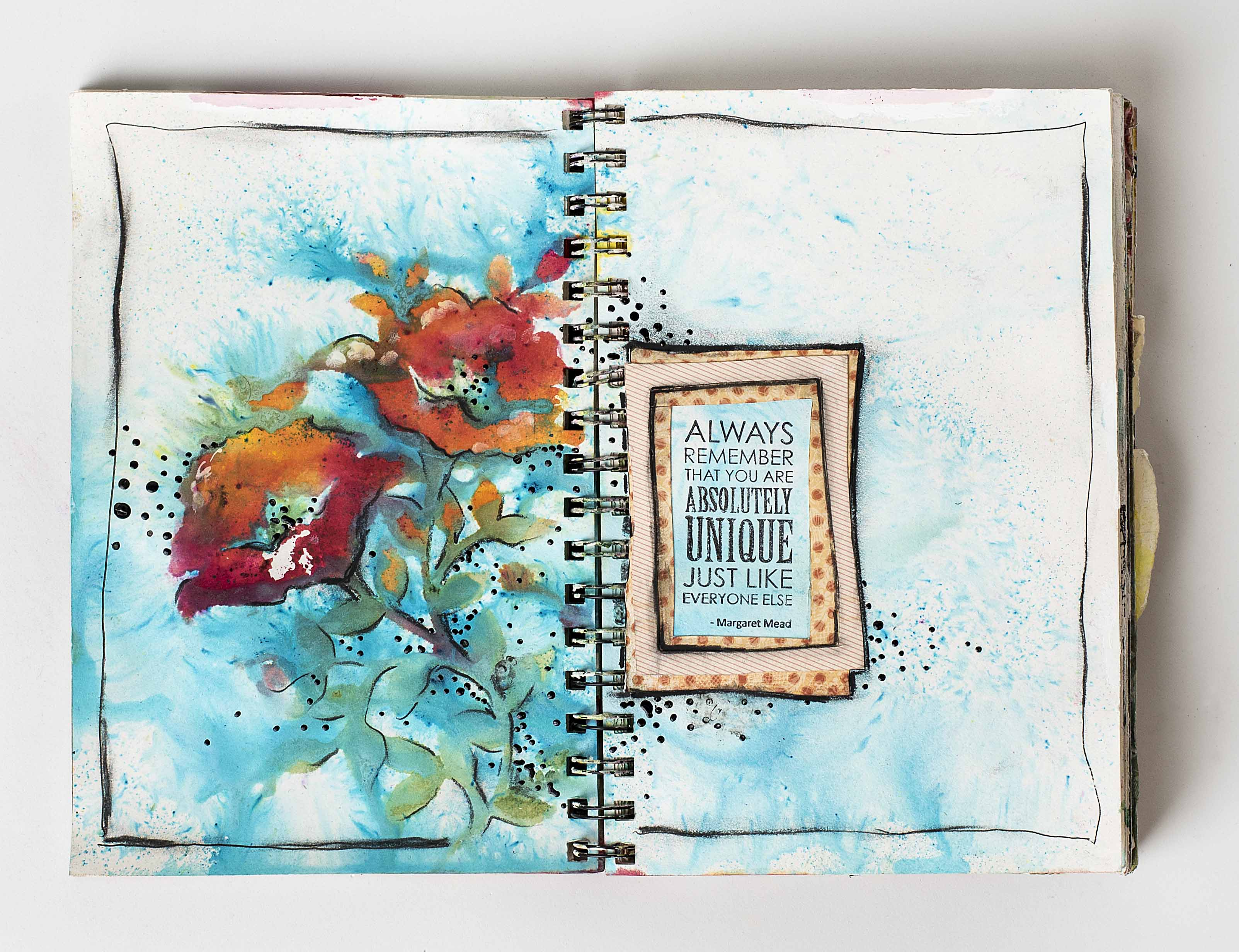 Art journal page designed by Christy Riopel featuring mixed media techniques with stencils, nuance powders and flower like images.