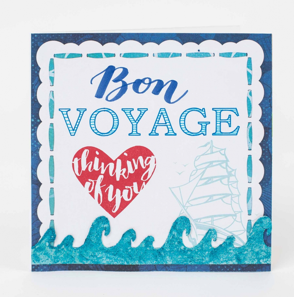 Bon Voyage scrapbook card designed by Kelly Klapstein featuring Brother ScanNCut and BoBunny glitter paste.