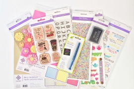 A collection of paper crafting products from MultiCraft Forever in Time including stickers, patterned paper, cardstock, ink, pens, alphabet stamps and flower die cut stickers.