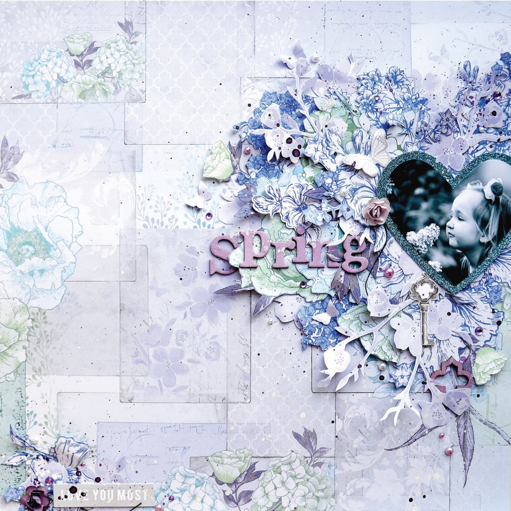 Scrapbooking layout designed by Tatiana Yemelyanenko of a little girl smelling a flower. The photo is black and white and cut out in the shape of a heart.