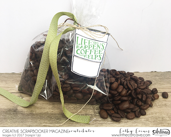 A stamped coffee tag featuring Stampin' Up! stamps attached to a clear bag of coffee beans.