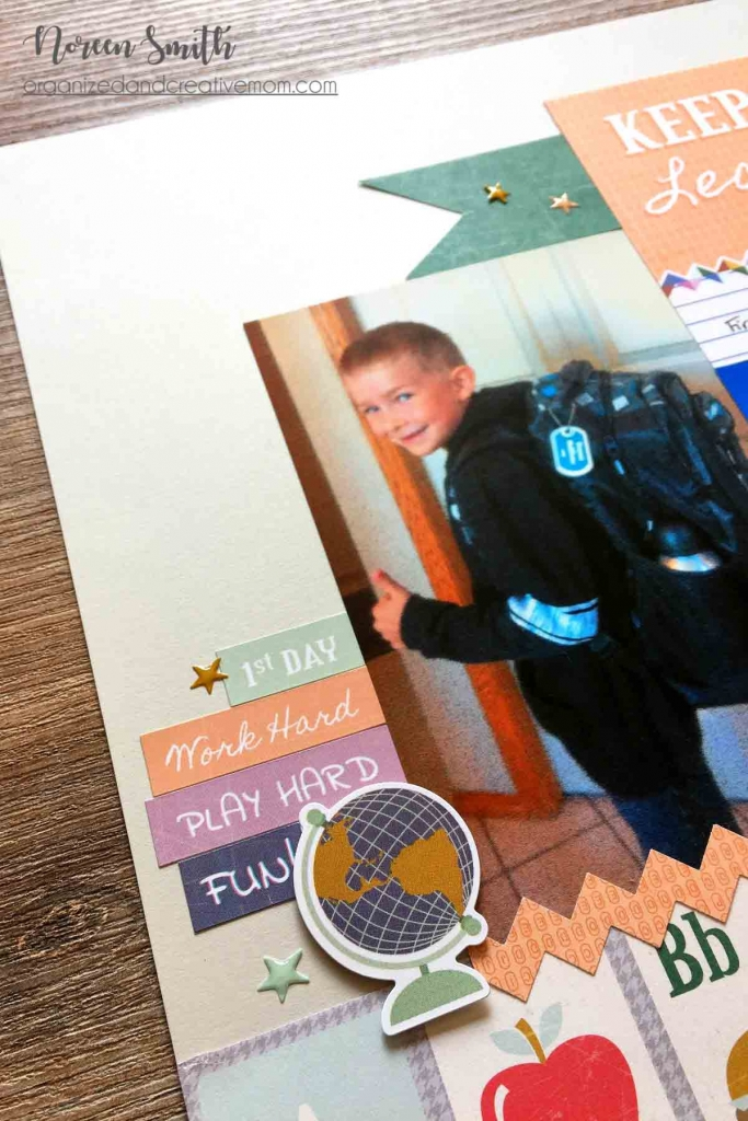 A scrapbook page of a little boy on the first day of school givning the thumbs up featuring the Bookworm collection from Creative Memories