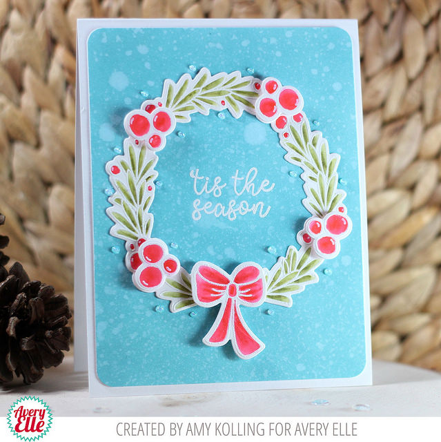 Christmas card designed by Amy Kolling featuring Avery Elle stamps including a wreath and sentiment.