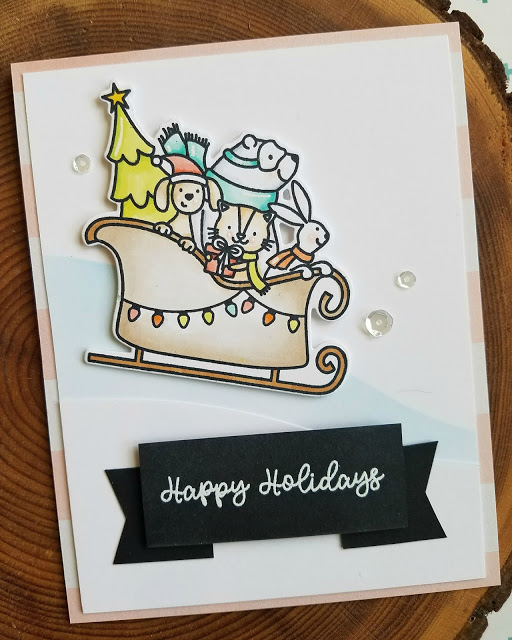 Christmas card designed by Ashley Marcu featuring Avery Elle winter animal stamps and sleigh.