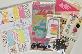 An assortment of Fancy Pants Designs scrapbooking products sponsored by Ninabrook Paper Crafting for a scrapbooking giveaway.