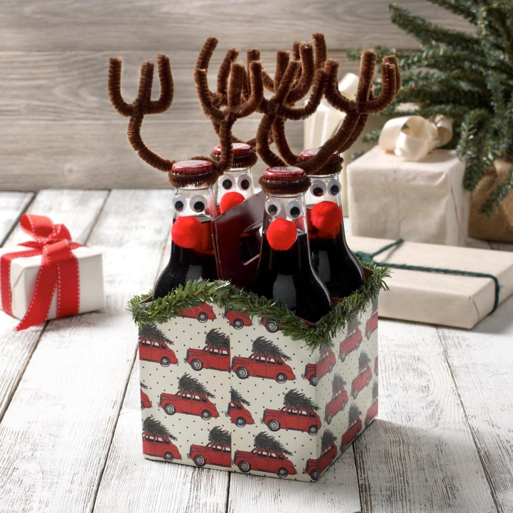 Six pack of bottles in an altered carrying case in a reindeer holiday theme featuring Plaid products.