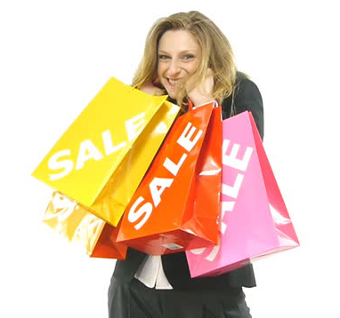 Woman with shopping bag who is very happy