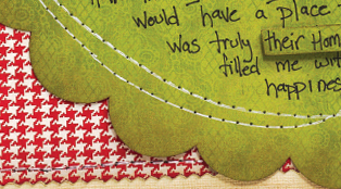 Close up of machine sewing on a scrapbook layout
