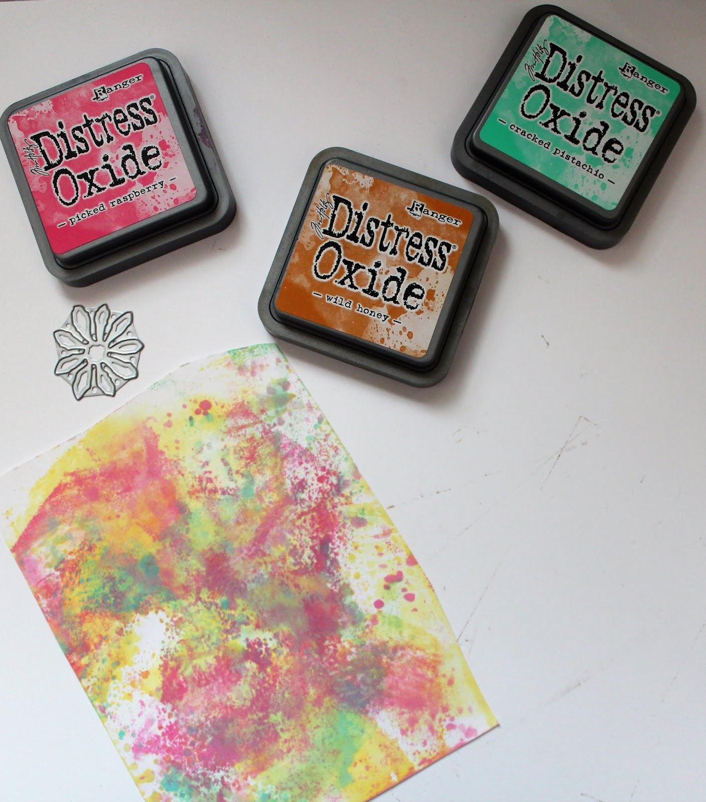 Creating a mixed media stencil using Ranger Distress ink and Sizzix dies