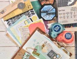 Supplies used to create a traveler's journal by Kerry Engel featuring Momenta, Clearsnap and Glue Dots