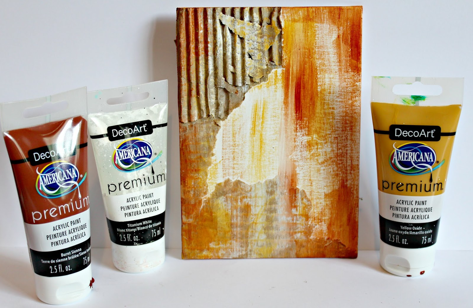 DecoArt acrylic paint used to create a background for a coffee mixed media canvas