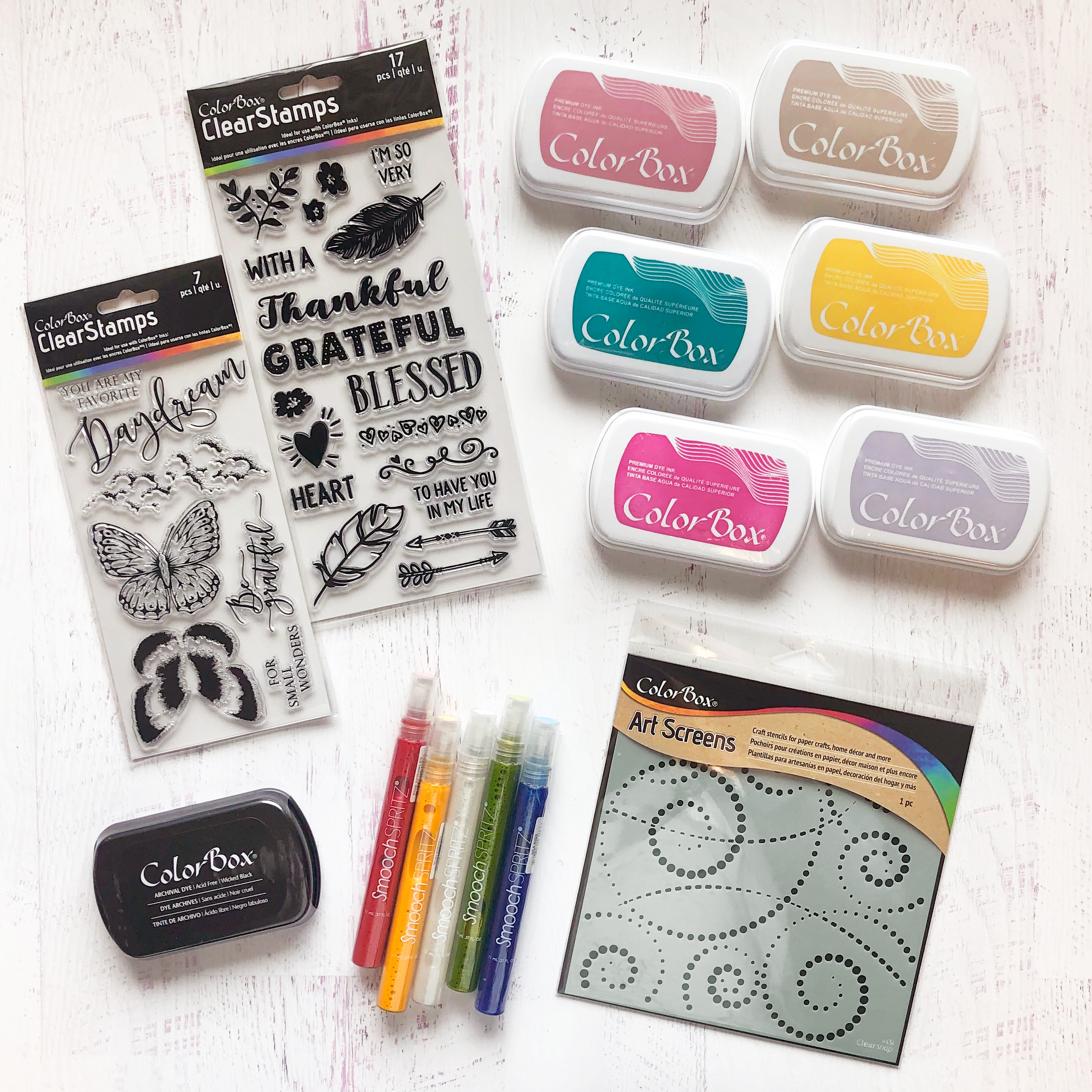 Paper Crafting prize package filled with ink stencils, ink spray and stamps from Clearsnap ColorBox