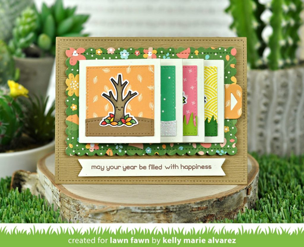 Scrapbook card using a Flippin' die from Lawn Fawn that make the card flip one page at a time when you pull a tab.