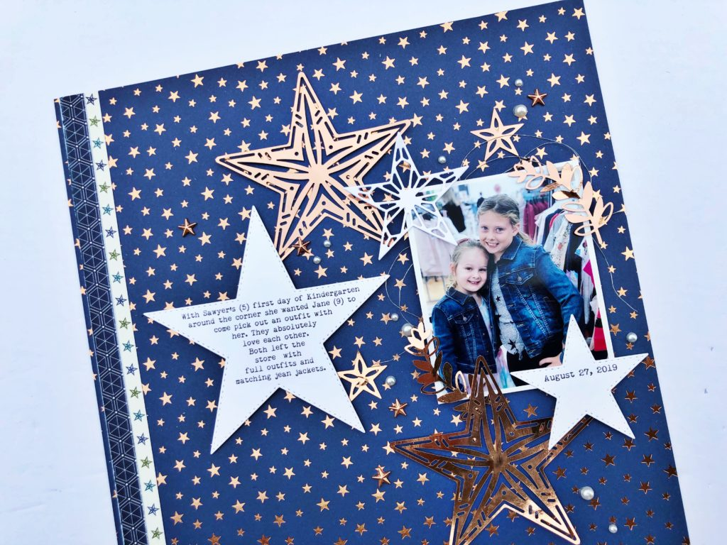 8 1/2 X 11 blue scrapbook layout with stars all over it. Layout featured the Stitched Stars Framelits by Stampin' Up!. Designed by Cathy Caines