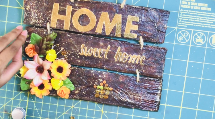 Details of a fall home decor wooden sign made of three pieces of wood decorated with The Robin's Nest Dewdrops