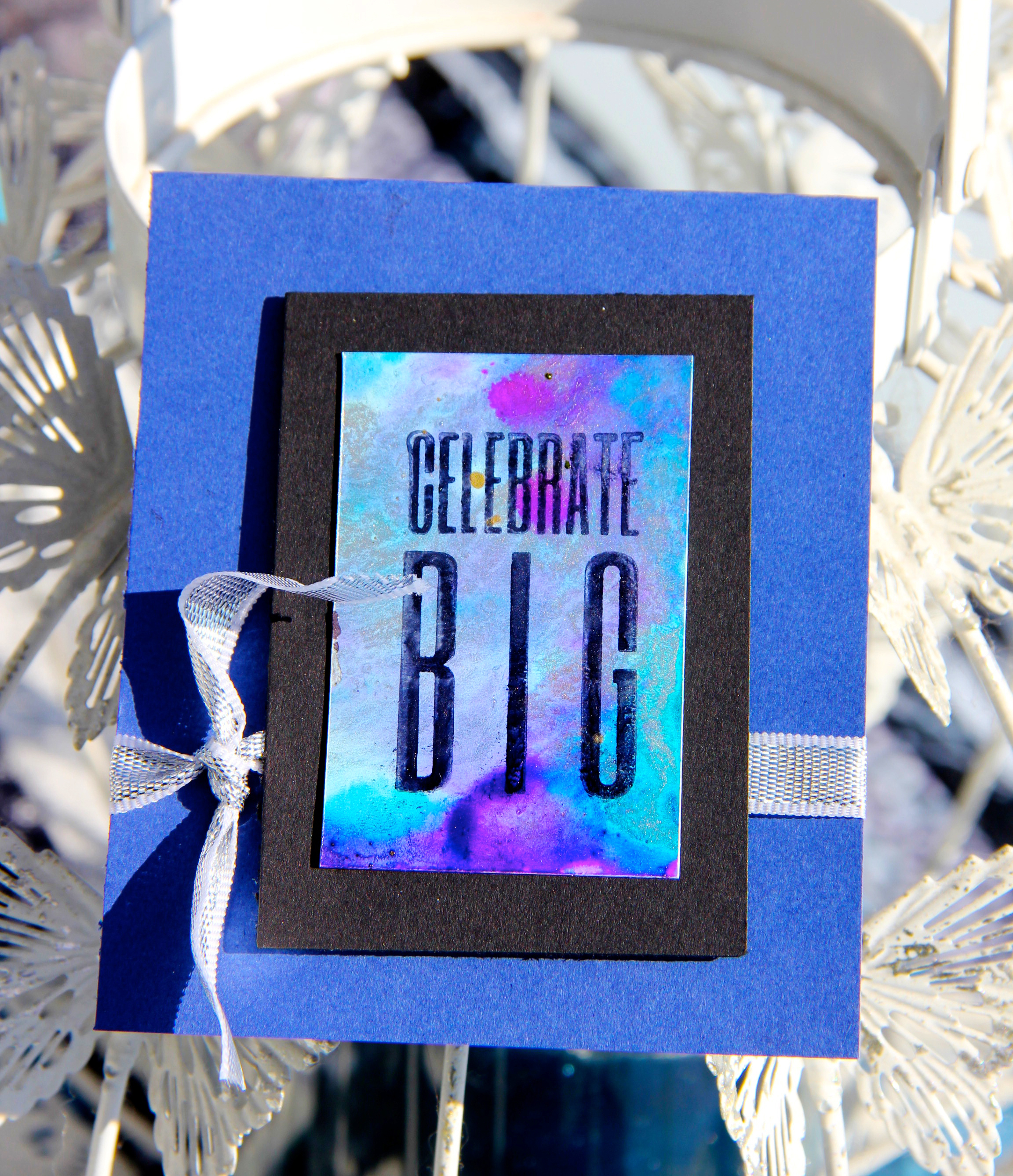 Celebrate Big scrapbook card in bright purples and blues featuring Ranger Tim Holtz Alcohol Ink Yupo paper and alcohol inks. Card designed by Jayme Loge