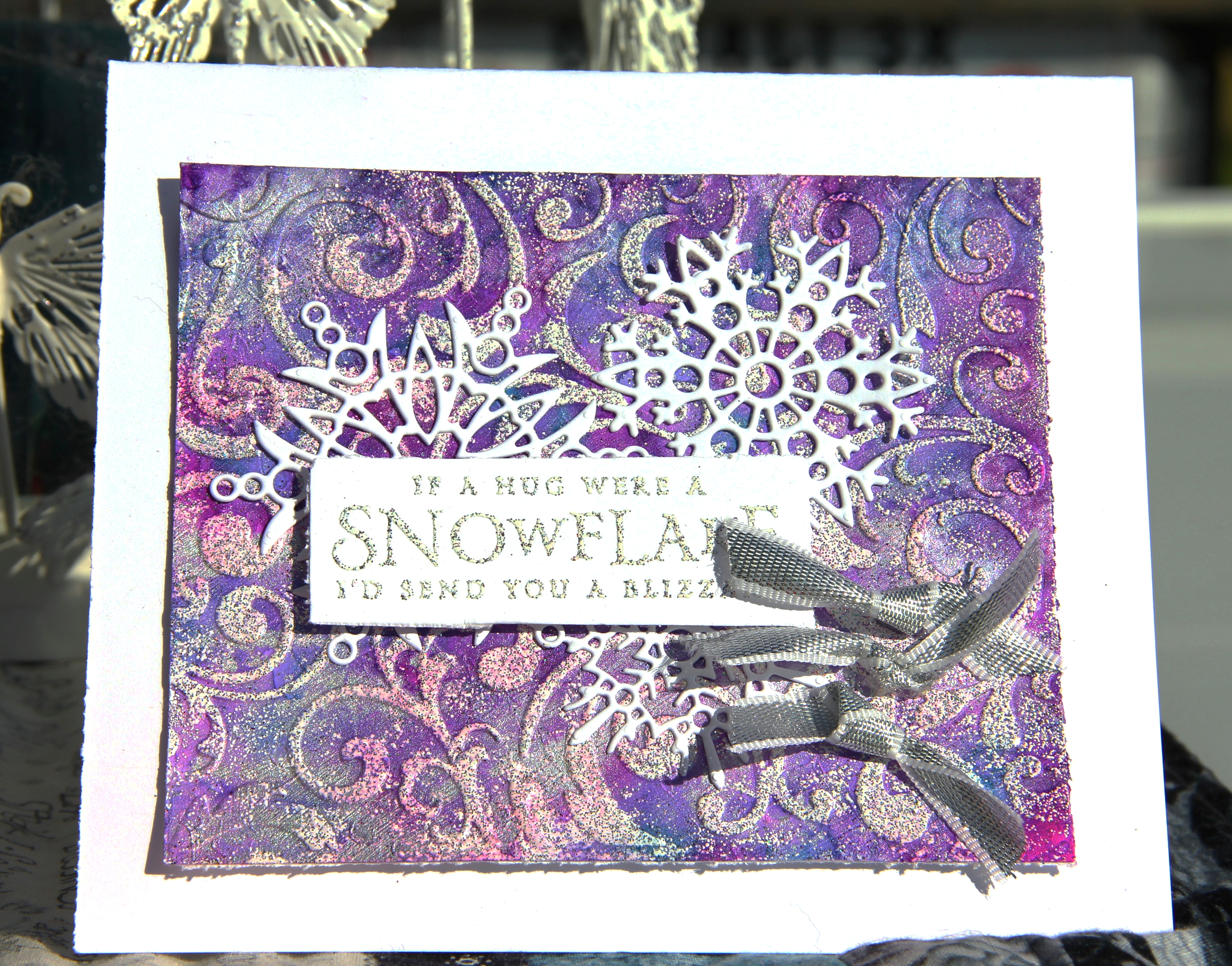 Christmas scrapbook card in bright purples and blues featuring Ranger Tim Holtz Alcohol Ink Yupo paper and alcohol inks. Card designed by Jayme Loge