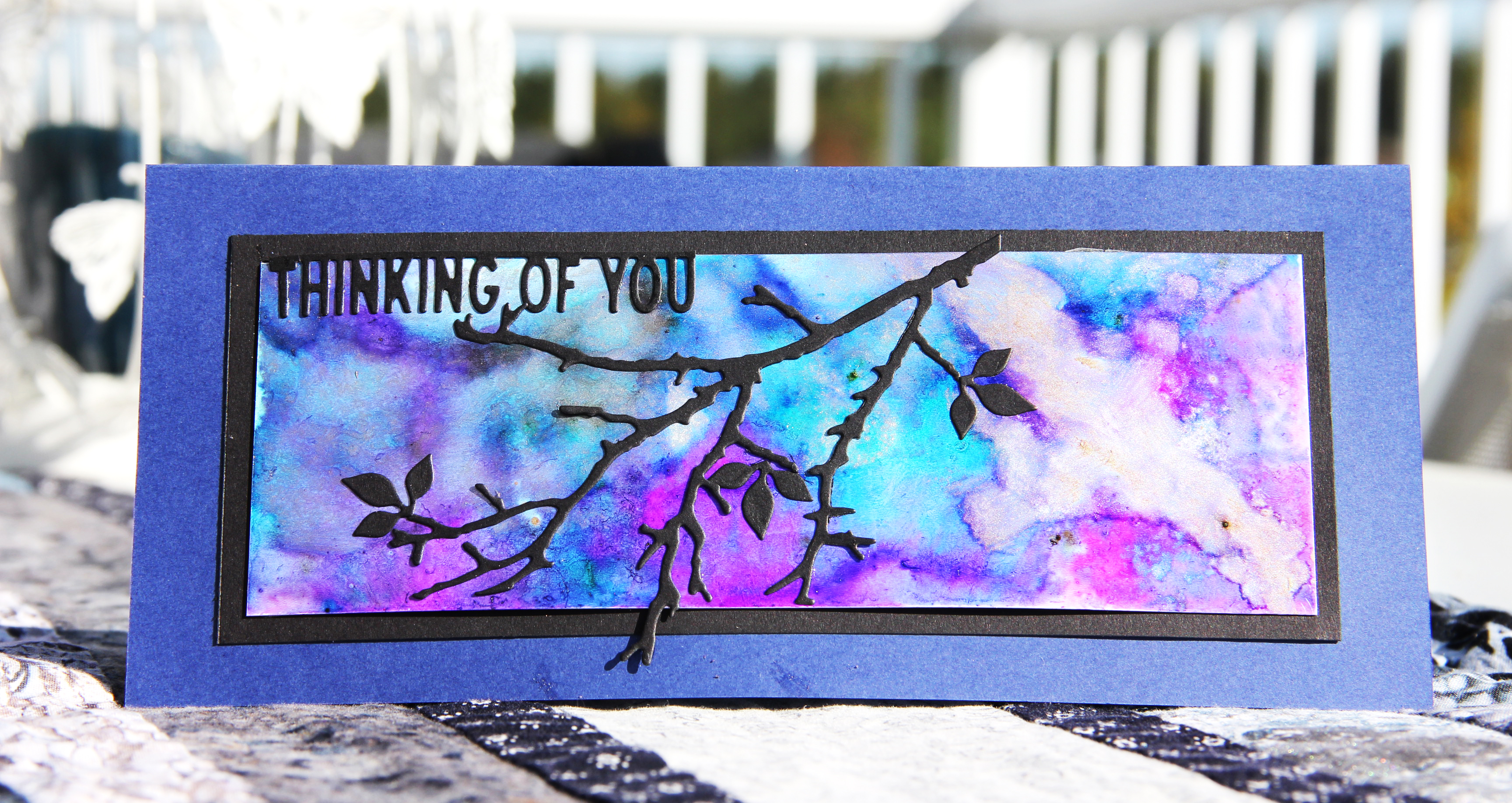 Thinking of you scrapbook card in bright purples and blues featuring Ranger Tim Holtz Alcohol Ink Yupo paper and alcohol inks. Card designed by Jayme Loge