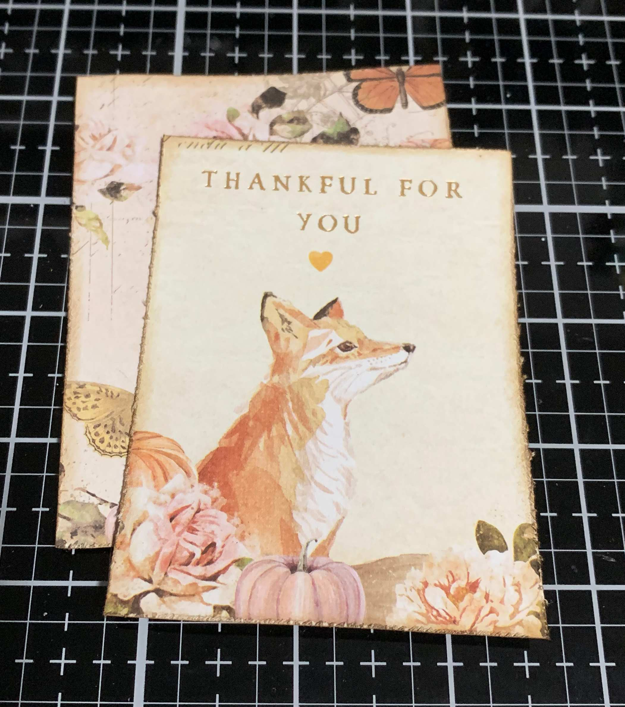 Prima Marketing Autumn Sunset Collection patterned paper with a fox on it.