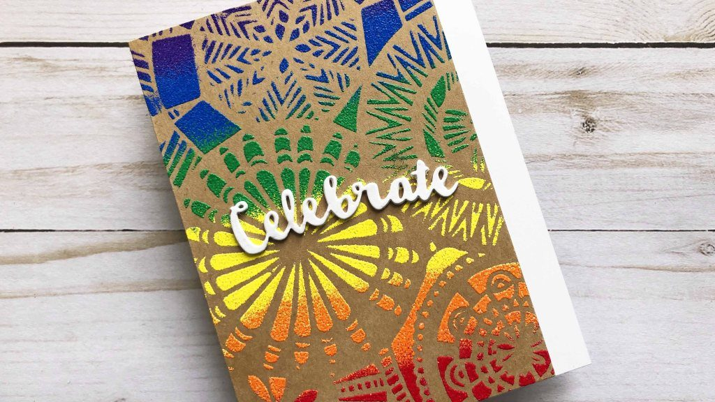 Heat embossing on a handmade scrapbook card featuring The Crafter's Workshop stencils. Cards designed by Lindsay Adreon