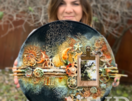 Nicole Wright holding beautiful plate designed with Prima Marketing products