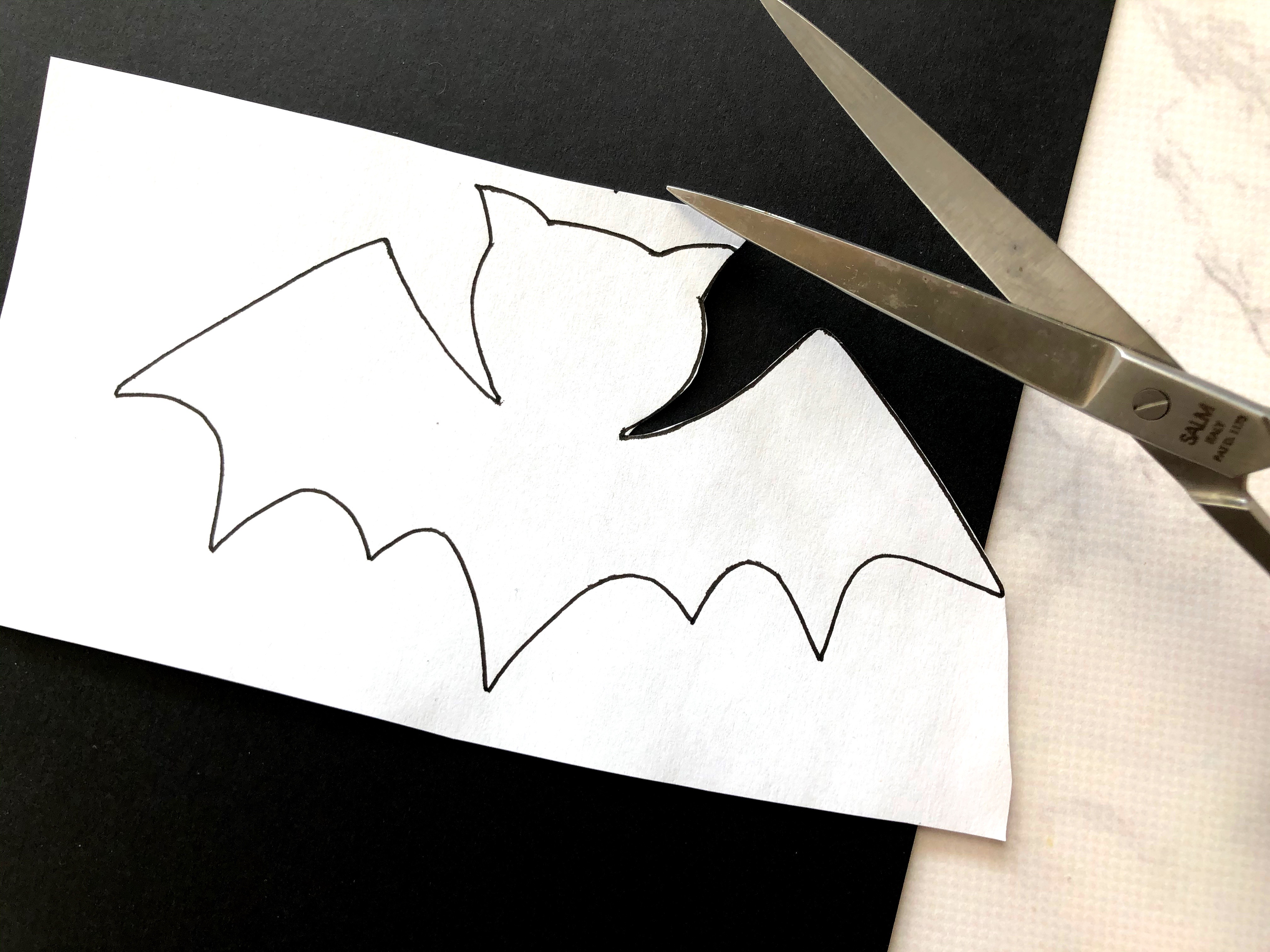 Cutting out a bat template designed by Kelly Klapstein