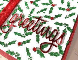 Christmas card designed by Kerry Engel featuring Green Glitz Glitter by Therm O Web and a Carta Bella Holly stencil