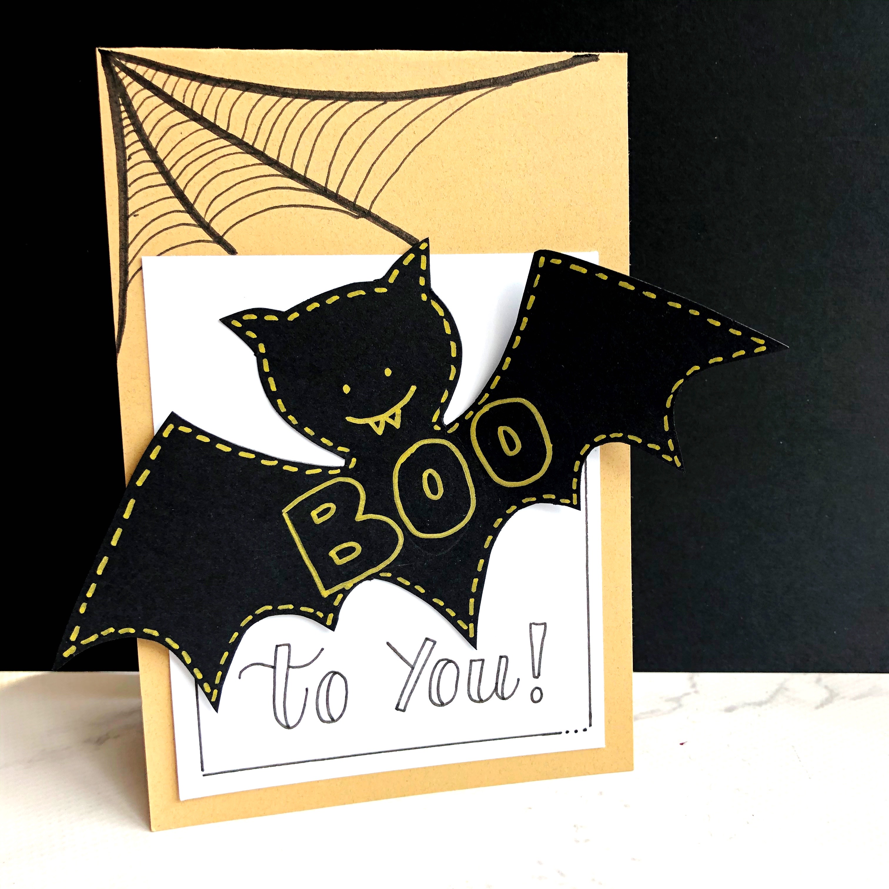 Halloween Card with a black bat on it designed by Kelly Klapstein featuring Kelly Creates